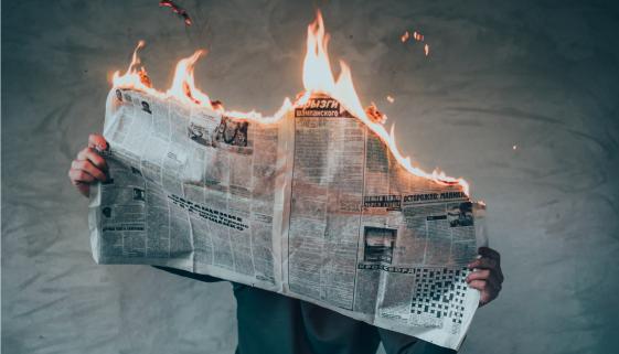 burning_newspaper